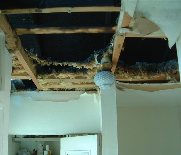 Damaged ceiling from fire damage.